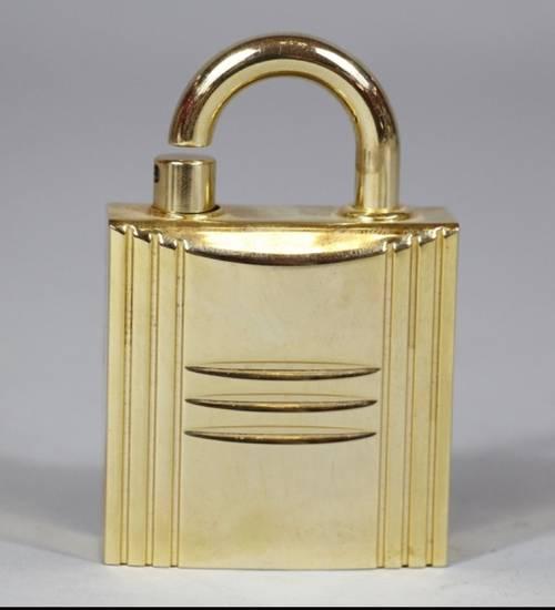 Vaporisateur à parfum rechargeable Hermes forme cadenas vintage luxe