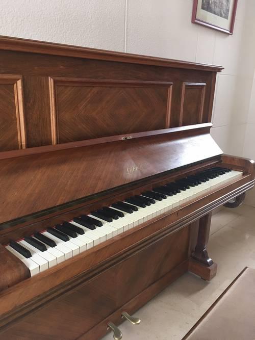 Vends piano droit mécanique