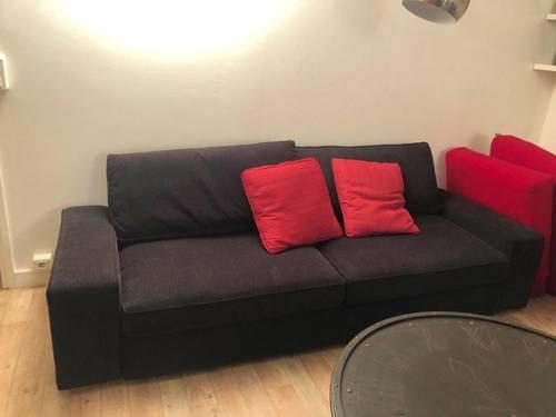 Canapé lit noir avec repose-pied avec rangements