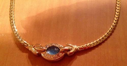 Vends collier fantaisie maillons dorés à pierre bleue