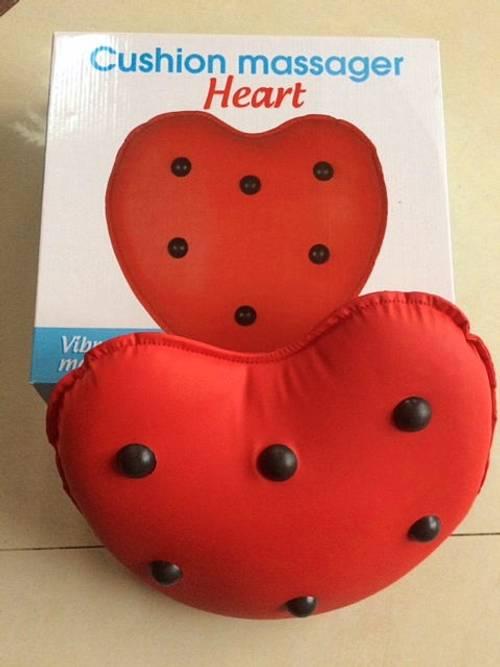 Vends coussin massant neuf en forme de coeur rouge