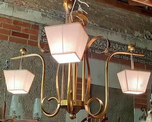 Vends lustre métal doré