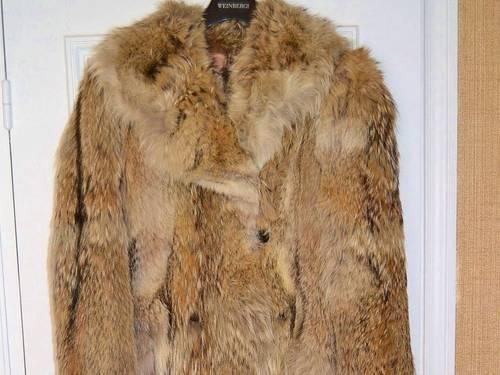Vends manteau en fourrure de loup T40