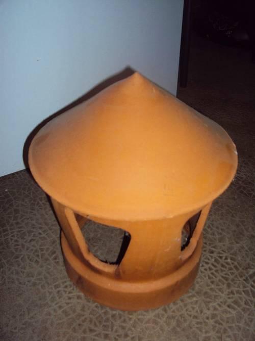 Vends lanterne neuve de cheminée en terre cuite
