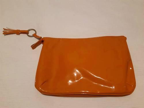Vends trousse de toilette Monoprix orange